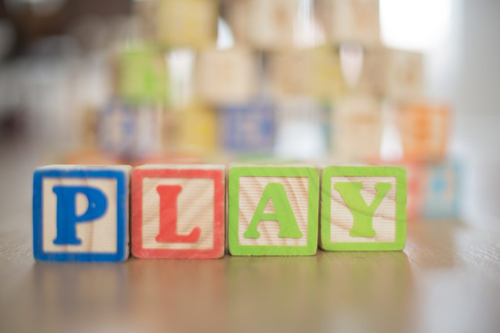 small wooden blocks that spell out the word PLAY