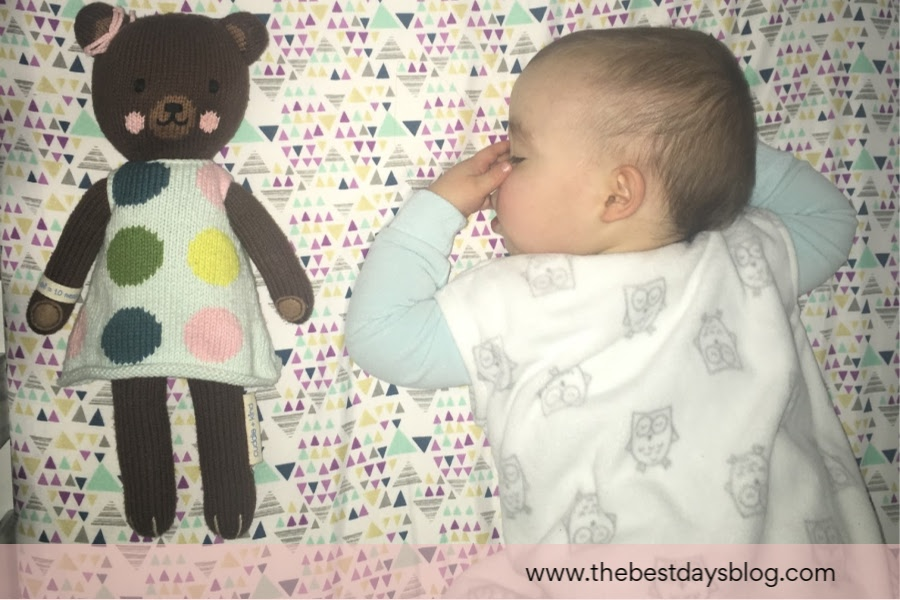 baby sleeping with doll
