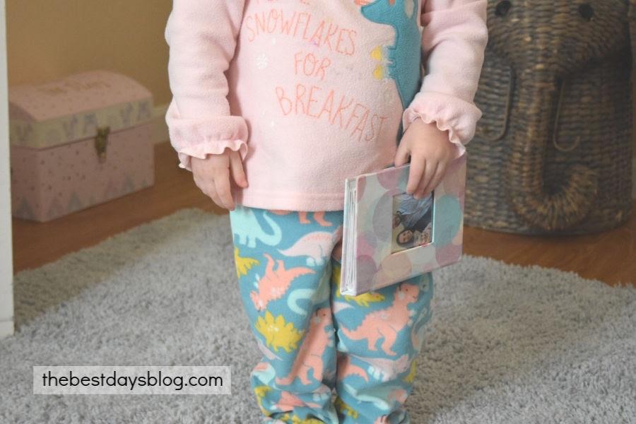 Toddler holding homemade book