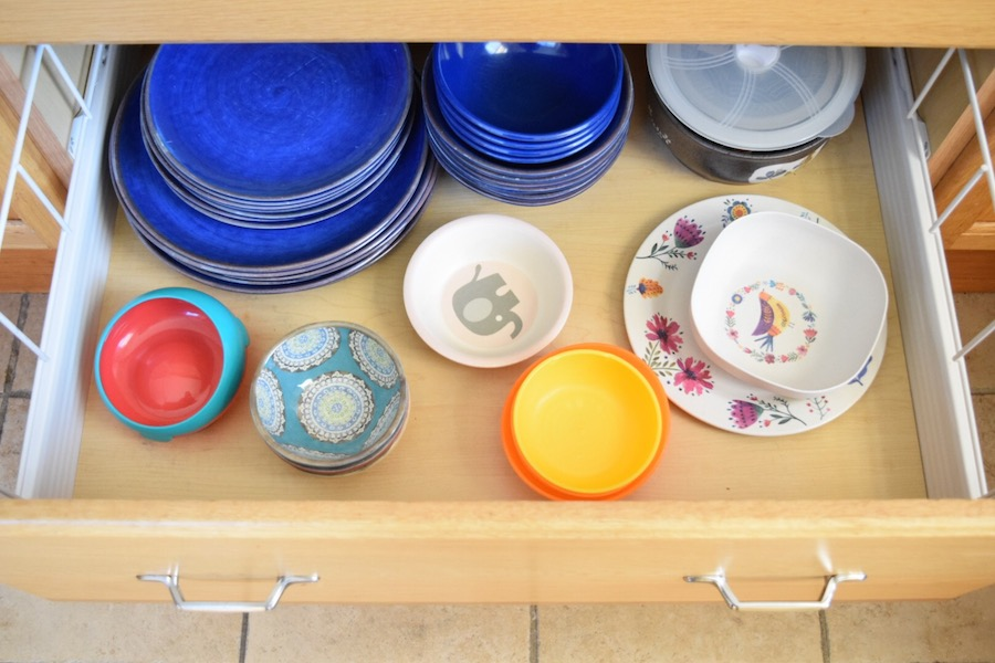 low drawer in kitchen for toddler to help out away plates and bowls