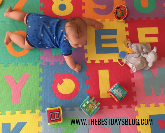 Baby doing tummy time while playing with toys