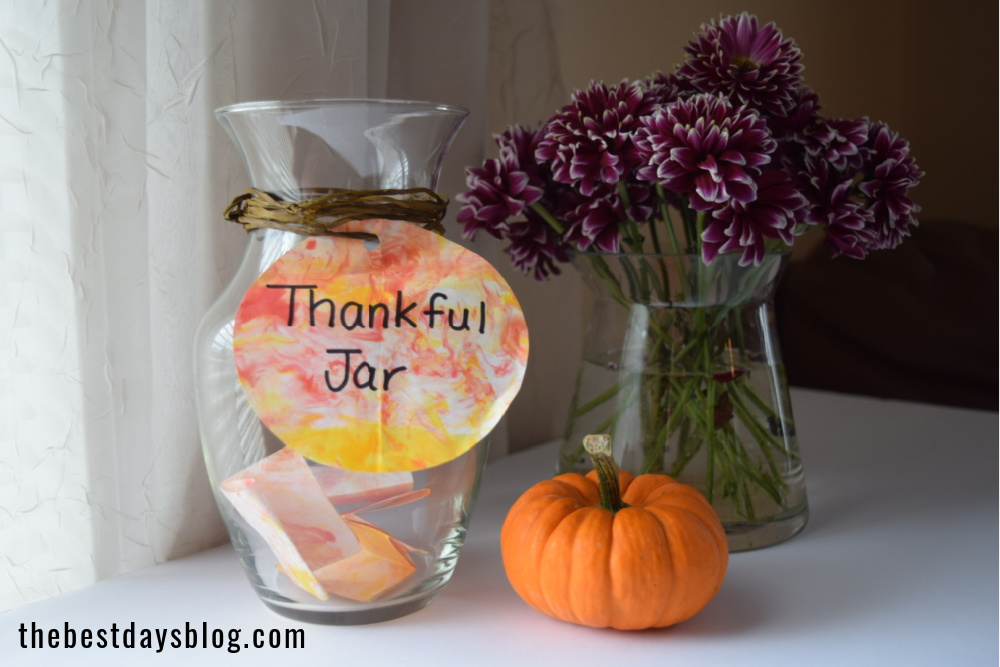 thankful jar activity with vase of flowers and pumpkin