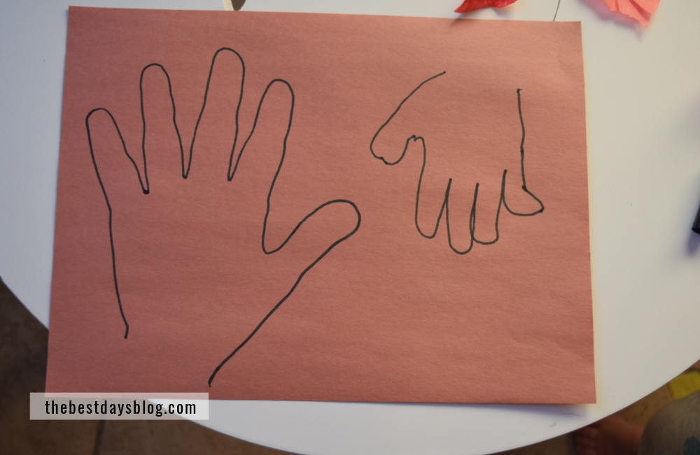 Brown construction paper with hand tracing to cut out and use as turkey bodies for turkey craft