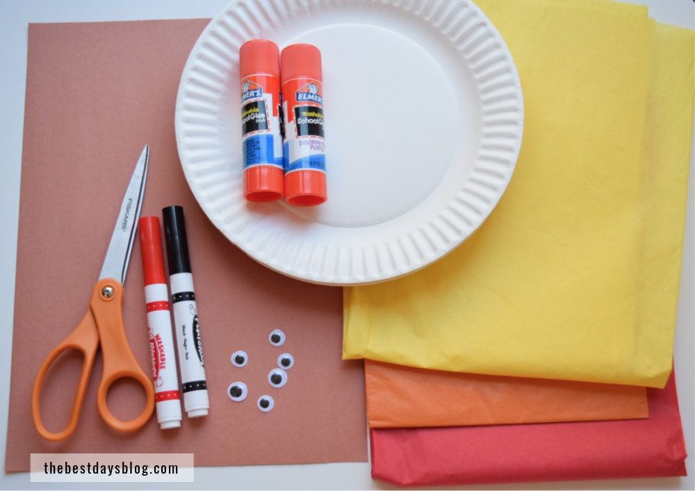 Supplies needed to make Thanksgiving turkey craft - scissors, markers, gluesticks, paper plates, tissue paper, construction paper and googly eyes.