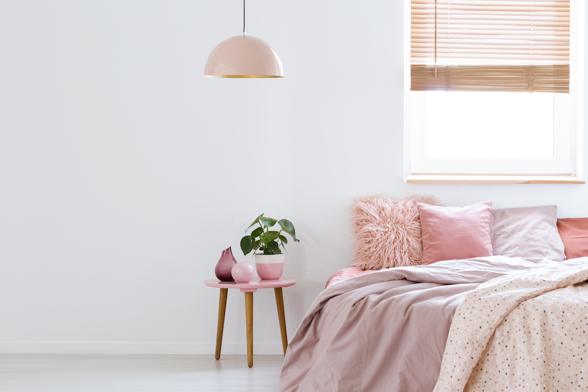 Picture of girls bedroom with pink bedding and pillows