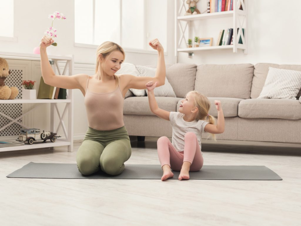 mom and daughter doing a workout together