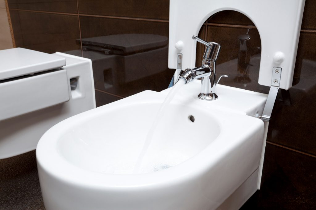 Bidet with water running from the faucet - this can be a natural way to relieve constipation while pregnant.