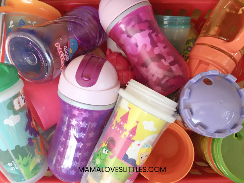 Many different types of toddler transition cups in a basket
