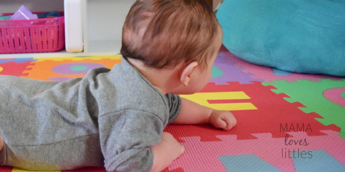 Baby doing tummy time on a playmat
