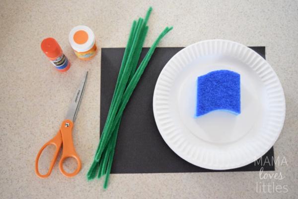Supplies to make easy Hallowen paper plate pumpkin craft - scissors, gluestick, pipe cleaners, orange pain, sponge, paper plates, black paper.