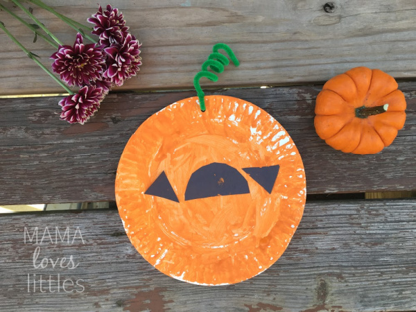 Halloween paper plate pumpkin craft made by 3 year old